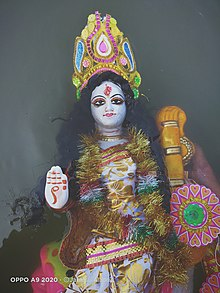 Immersion of an idol of Saraswati (Babughat Kolkata).jpg