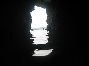 Norman Island - Snorkeling inside a cave at Norman Island, the island of Tortola is visible in the background