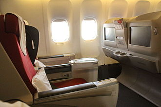 Business class - Interior of business class cabin of Biman Bangladesh Airlines Boeing 777-300ER en route to Dhaka from Jeddah
