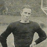 Player in dark jersey, hands on hips