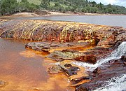 The red appearance of this water is due to iron in the rocks.