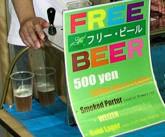 "Gratis versus libre - Free Beer sale on the Isummit 2008 illustrates ""Free as in freedom, not free as in free beer"": recipe and label shared openly under CC-BY-SA (""Free as in freedom"") but not gratis (""free as in free beer"") as the beer is sold for 500 Yen."