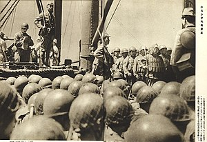 Battle of Borneo (1941–42) - Japanese paratroopers of the 2nd Yokosuka Naval Landing Force under the command of Lieutenant Colonel Genzo Watanabe (standing on top in the left) inside a transport ship heading to Borneo prior to their invasion in December 1941.