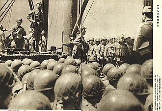Japanese occupation of British Borneo - Japanese paratroopers of the 2nd Yokosuka Naval Landing Force under the command of Lieutenant Colonel Genzo Watanabe (standing, top left) on a transport ship heading to Borneo prior to their invasion in December 1941.