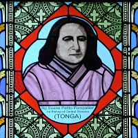 "A man with shoulder-length black hair, wearing a lilac tunic, is shown in a colored glass window. In the glass beneath the picture is his name and the phrase ""1st Bishop of Central Oceania (Tonga)"""