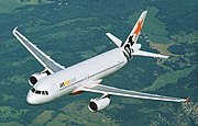 Jetstar Airbus A320 in flight (6768081241) crop.jpg