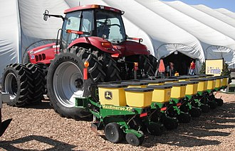 Planter (farm implement) - John Deere MaxEmerge XP Planter with Case IH AFS precision farming system which auto-steers using GPS