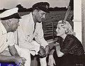 John Farrow, John Wayne, and Lana Turner.jpg