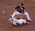 John Mayberry, Jr. steals second base; JJ Hardy seeks to catch the throw-cropped.jpg