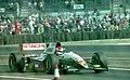 Johnny Herbert - Lotus 109 leavs the pits at the 1994 British Grand Prix (32162262590).jpg