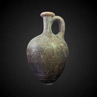 Tell el-Yahudiyeh Ware - Ovoid jug featuring the ornamental engravings filled with white coating characteristic of the Tell el-Yahudiyeh Ware style. Found by Pierre Montet at Byblos necropolis in 1923, on display at the Louvre Museum.
