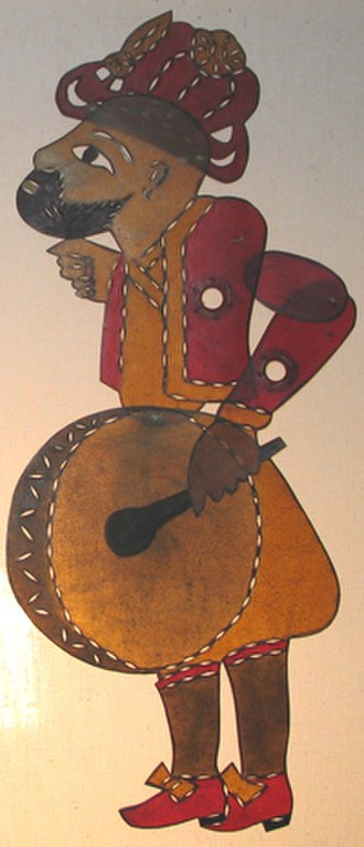Davul - Davul in shadow puppet theater. Here, Karagöz is shown with his davul.