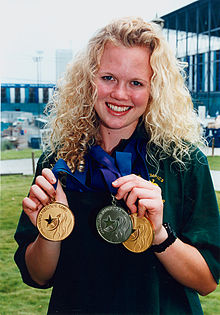 Katrina Webb holding her medals at the 1996 Atlanta Paralympic Games.jpg