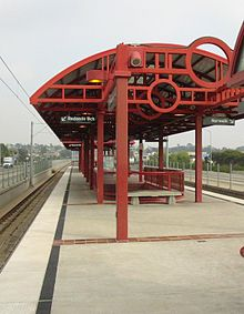 The architectual design of Crenshaw Station.  Many stations on the Green Line  have this configuration.
