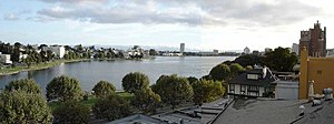 Lake Merritt - Looking Southwest across Lake Merritt. In the distance are the Rene C. Davidson Alameda County Court House and Henry J. Kaiser Convention Center. At the right is the Bellevue-Staten Building.