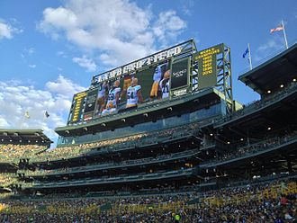 Lambeau Field - A view of the 2013 Lambeau Field seating expansion in the south end zone and one of the new HD video boards