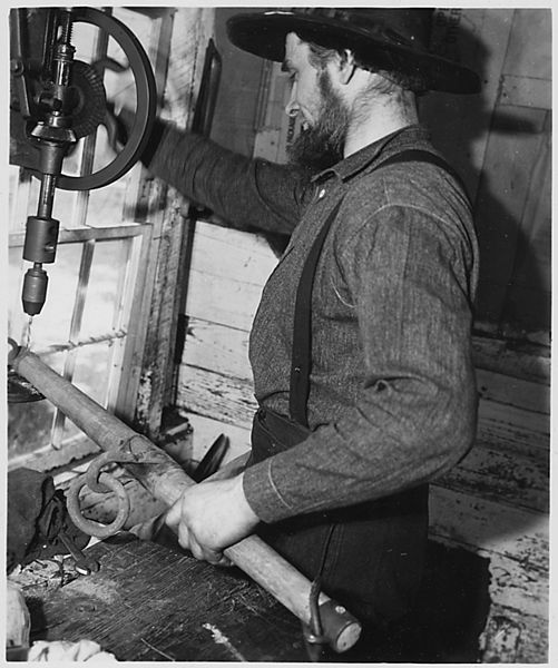 File:Lancaster County, Pennsylvania. An Old-Order Amishman working in his repair shop. Good machine sho . . . - NARA - 521078.jpg