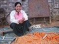 Lao woman peeling corn.jpg