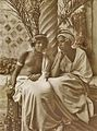 Lehnert et Landrock - Couple posed in courtyard against pillar - ca. 1912.jpg