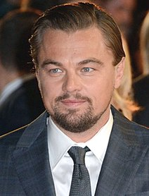Leonardo DiCaprio smiling at the camera.