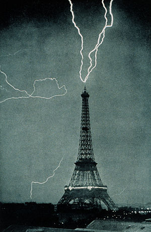 Lightning strikes the Eiffel Tower, France in 1902.