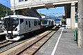 Limited express Azusa and Resort View Furusato trains at Minami-Otari Station 20101002.jpg