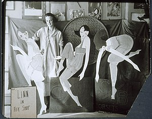 Standee - Image: Lin standing behind an advertising display, ca. 1917 1925. (9452899028)