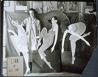 Standee - Image: Lin standing behind an advertising display, ca. 1917 1925. (9452899028)