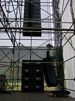 A line array speaker system and subwoofer cabinets at a live music concert