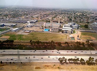 Los Angeles Southwest College - Aerial view of LA Southwest College from the south, with the I-105 freeway in foreground and practice baseball fields.