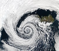 A low pressure area over Iceland shows an approximately logarithmic spiral pattern
