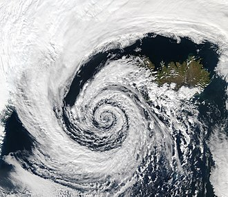 Coriolis force - This low-pressure system over Iceland spins counterclockwise due to balance between the Coriolis force and the pressure gradient force.