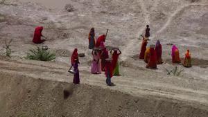 National Rural Employment Guarantee Act, 2005 - Women employed under NREGA for de-silting a tank