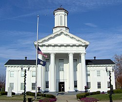 Madison County courthouse, Richmond, with flags at half-staff in honor of Veterans Day (2007).
