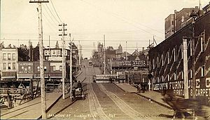 Madison Street (Seattle) - Looking east on Madison Street from Western Avenue circa 1891, showing  cable car tracks