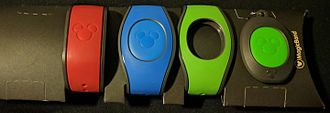 MagicBands - From left to right: Red (original) MagicBand, Blue MagicBand 2 with Icon, Green MagicBand 2 without Icon, MagicKeeper with Green Icon.