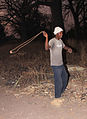 Man of a tribe in Gambia with sling weapon.jpg