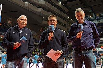 Color commentator - Main commentator Arsenio Cañada (middle) introduces the basketball game between CB Estudiantes and CB Málaga assisted by two color analysts: Manel Comas (left), former coach, and Juanma Iturriaga (right), former player.