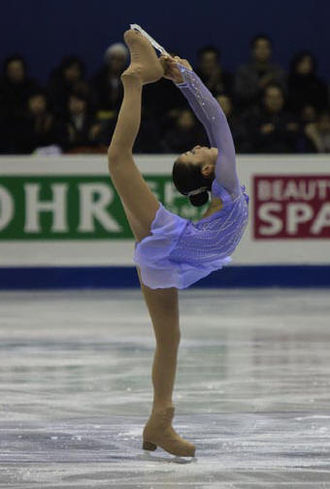 Short program (figure skating) - Mao Asada performs a Biellmann spin during her short program at the 2008-2009 Grand Prix Final
