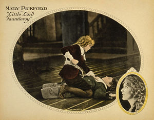 Lobby card showing Mary Pickford about to punc...
