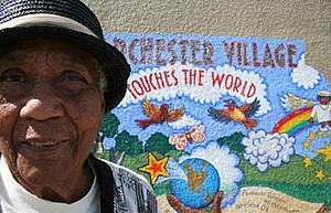 "Parchester Village, Richmond, California - Mary ""Peace"" Head longtime Parchester Village activist by the peace mural."