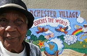 "Parchester Village, Richmond, California - Mary ""Peace"" Head longtime Parchester Village activist by the peace mural."