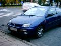 Mazda.323-violet.front-by.ranger.JPG