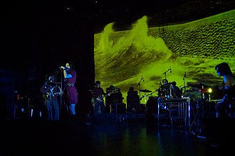 Mazzy Star - Mazzy Star in London 2012. From left to right: David Roback, Hope Sandoval, Colm Ó Cíosóig, Keith Mitchell (drums), Suki Ewers (keyboards)
