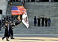 Members of the Joint Armed Forces Color Guard perform a pass in review in front of President Barack Obama, on stairs, second from left; first lady Michelle Obama, left; Vice President Joe Biden, second from 130121-F-AV193-287.jpg