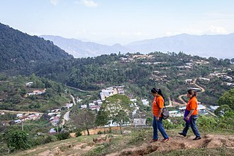 Partners In Health - Community Health Workers, Yadira Roblero and Magdalena Gutiérrez, walk down the mountain side to complete their home visits in Laguna Del Cofre, Chiapas, Mexico on March 11, 2016.