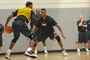 NBA player LeBron James (left) prepares to tak...