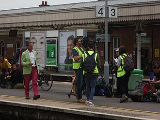 Michael Portillo - Filming at Taunton Station, in trademark exotic colours, 2017
