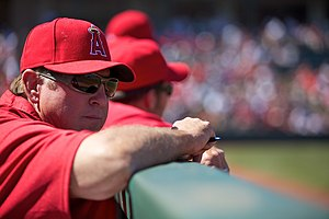 Angel coach Mickey Hatcher watches the game fr...
