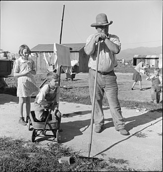 The Harvest Gypsies - Outskirts of Salinas, California. Rapidly growing settlement of lettuce workers. Family from Oklahoma settling in makeshift dwelling - Dorothea Lange 1939